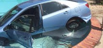 Woman Drives Camry Into Swimming Pool