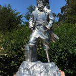 Sculpture of a pirate outside the deYoung Museum, by the sculptor Peter Coffin. It has 2 peg legs, 2 hooks for hands, wears 2 eye patches, and 2 parrots on his shoulders