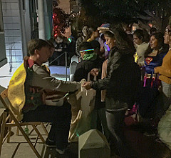 Man giving candy to a girl