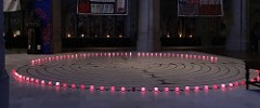Labyrinth surrounded by candles and panels from the AIDS Quilt (part of World AIDS Day)